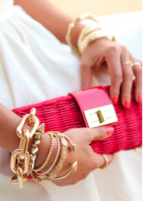 Pink clutch style combined with Gold bangles.