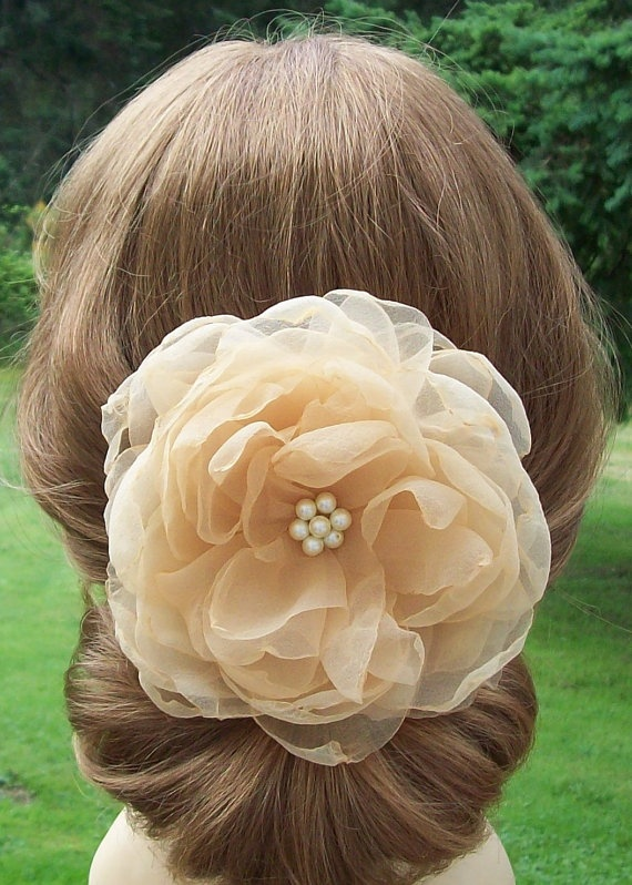 a simply elegant flower clip for a formal event hairstyle.
