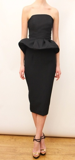 Peplum style little black dress.