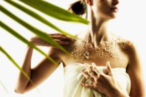 Woman enjoying exfoliating spa treatment